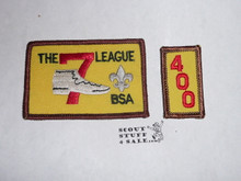 The 7 League High Adventure Team (HAT) Award Patch, 400 nights segment, rolled edge