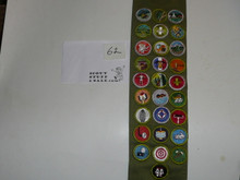 1970's Boy Scout Merit Badge Sash with 28 Fully Embroidered Merit badges and other patches, #62