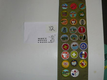 1970's Boy Scout Merit Badge Sash with 26 rolled edge Merit badges, #82