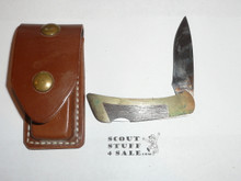 Gerber Buck Knife with Leather holder.  New but slight discoloration on brass to be cleaned