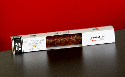 •100% Iberico •Traditional pimento seasoned Spanish sausage •Mild, dry cured •By Fermin •La Alberca, Salamanca Spain •Marinated with salt Pimenton and garlic •7 oz  / 200 g