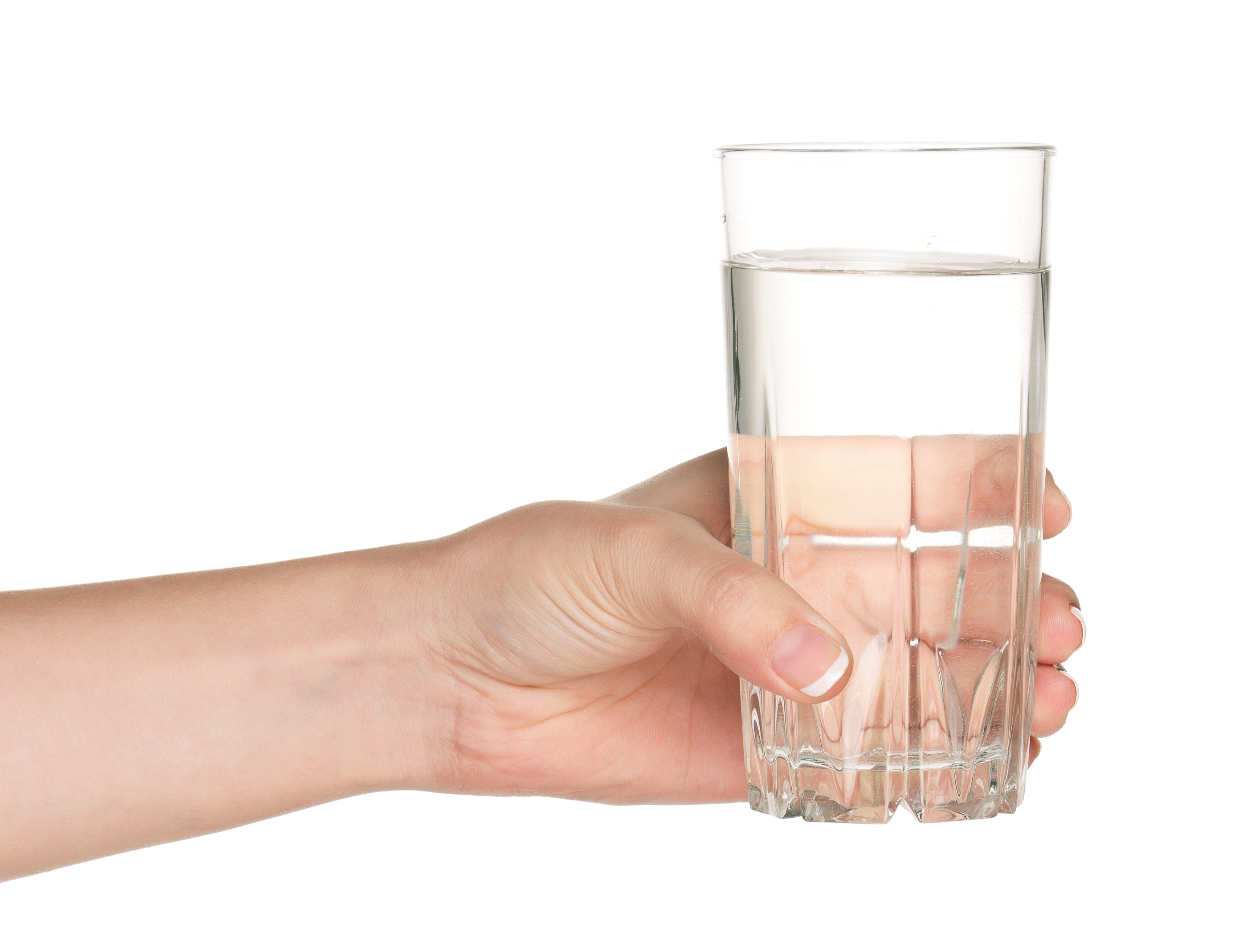 woman's hand holding glass of water