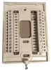 Thermostat backplate showing I/O terminals.