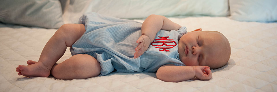 monogrammed-baby-gifts-banner-baby-clothes.jpg