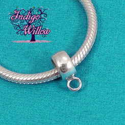 This little charm converter makes any of our dangling breast milk jewelry pieces into charms that fit perfectly onto Pandora and other European-style bracelets.