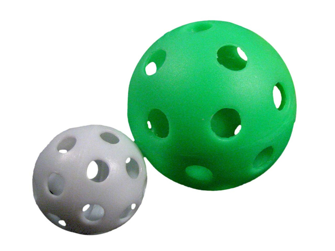 The two sizes of Wiffle Balls shown together