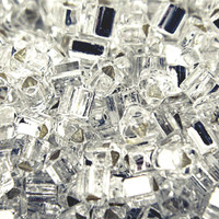 Size 8 Toho Triangle Beads, Crystal Silver Lined (1 ounce)
