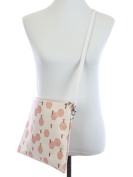 BAG ACCESSORY / BEEHIVE PRINT / VINYL CROSSBODY CLUTCH / ZIP CLOSURE / REMOVABLE ADJUSTABLE STRAP / INNER LINING / SLIP POCKET / ONE SIZE / 13 INCH WIDE / 10 INCH TALL / NICKEL AND LEAD COMPLIANT