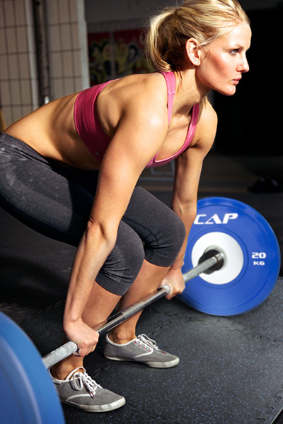 Woman performing deadlift exercise