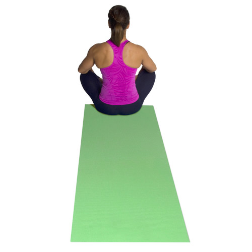 Model sitting on green CAP Fitness Yoga Mat