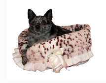 3-In-1 Reversible Snow Leopard Snuggle Bug functions as a pet bed, a car seat or a shoulder tote.