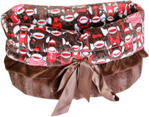 3-In-1 Reversible Funky Monkey Snuggle Bug functions as a pet bed, a car seat or a shoulder tote.