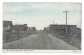 Chouteau, Oklahoma Postcard:  Main Street Looking West & Railroad Station
