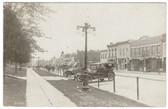West Union, Iowa Real Photo Postcard:  Downtown Street, Cars, & Dentist