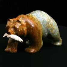 Bear Walking with Fish Stone Sculpture
