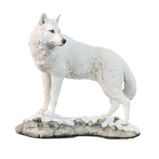 White Wolf Sculpture on Snowy Ground