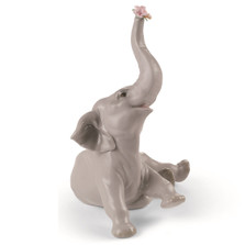 Baby Elephant with Pink Flowers Porcelain Figurine