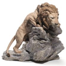Lion Pouncing Porcelain Figurine
