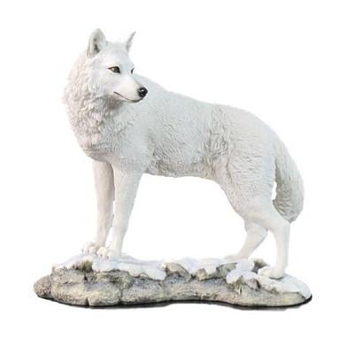 White Wolf Sculpture on Snowy Ground