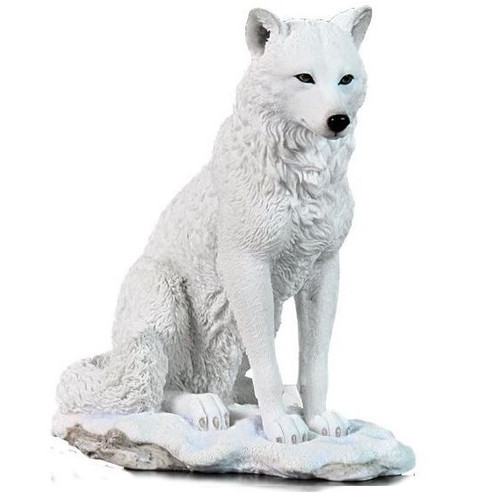 White Wolf Sculpture Sitting in Snow