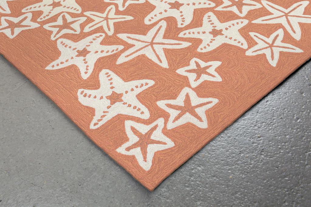Starfish Coral Orange Rug corner close up