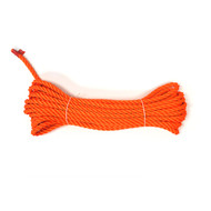 "7/16"" polyester three strand rope in bright orange."