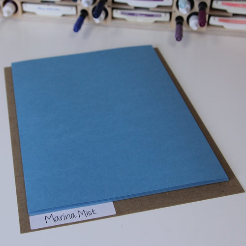 The Paper Holder Label System chipboard pieces are a little larger than the 8.5x11 paper so the labeled area sticks out.