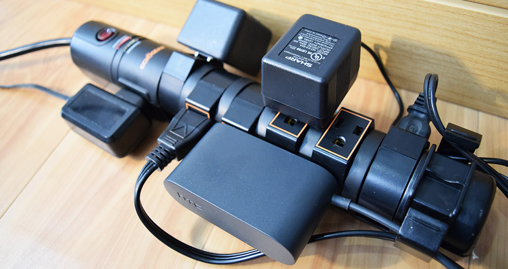 Power strip surge protector with rotating heads