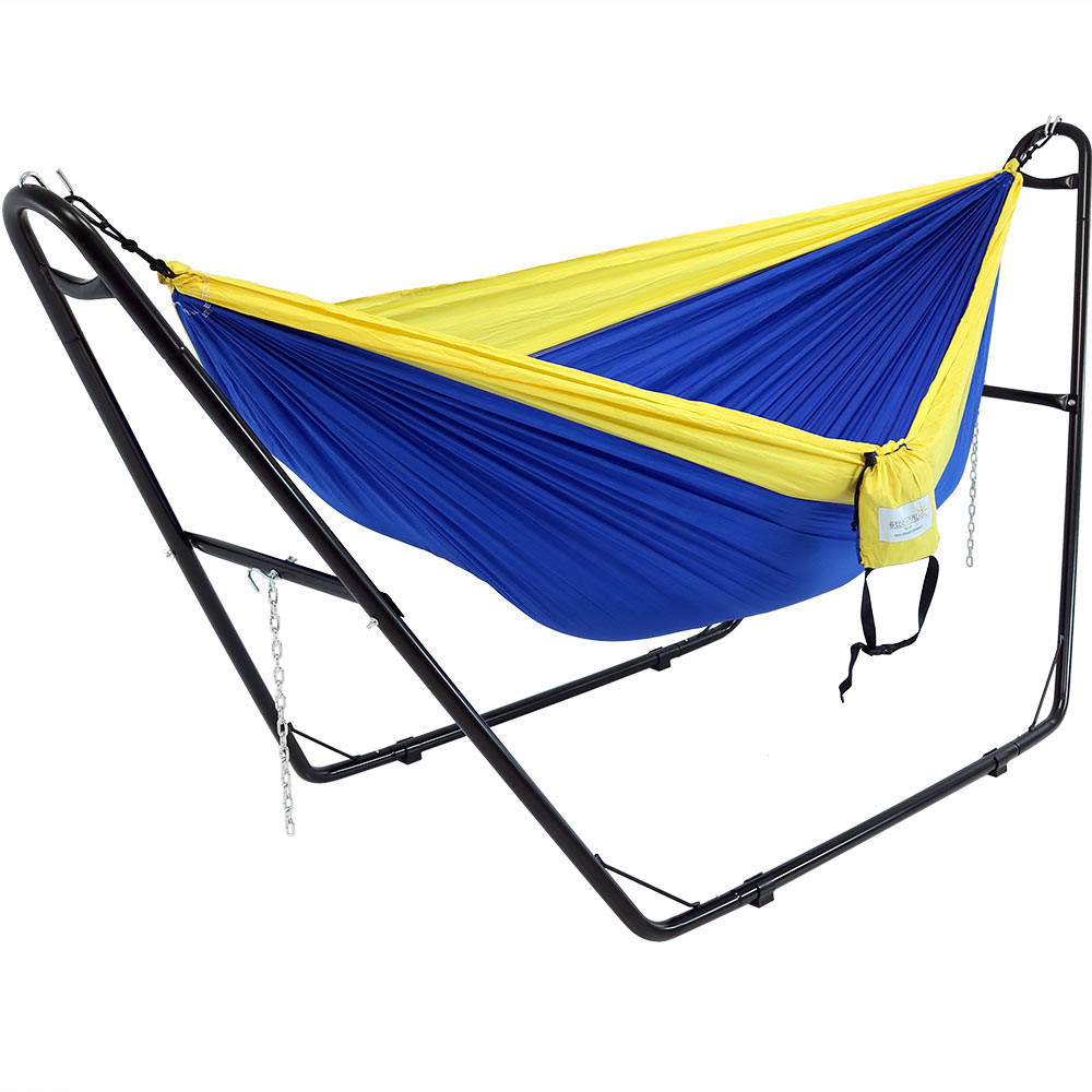 stand shown with a camping hammock  hammock not included  sunnydaze universal multi use heavy duty steel hammock stand 2      rh   serenityhealth