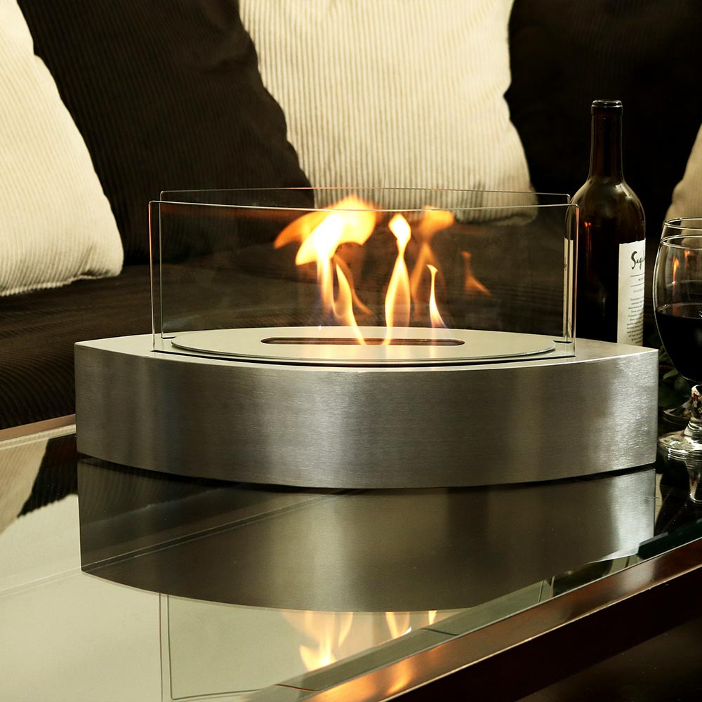 Add a pop of warmth and style to your space with the Sunnydaze Barco Ventless Bio Ethanol Tabletop Fireplace from Serenity Health.