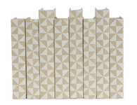 White geometric pattern on cream background - priced by the book