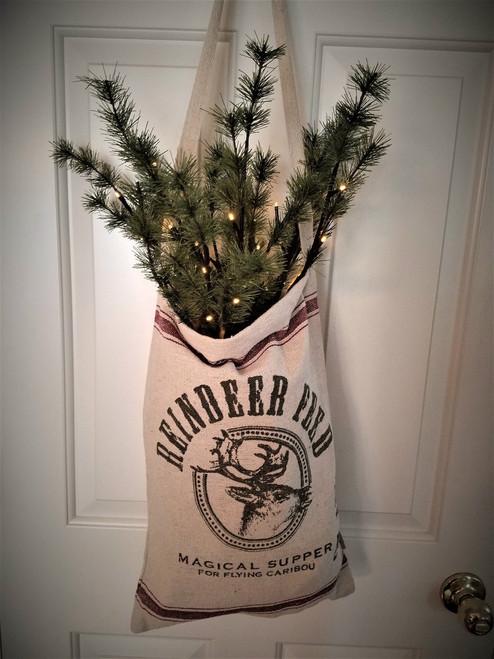 Reindeer Feed Bag With One Stem Pine Twigs, Pre-Lit.