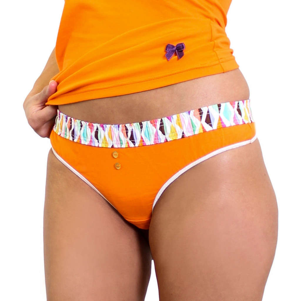 Orange thong panty with colorful confetti waistband