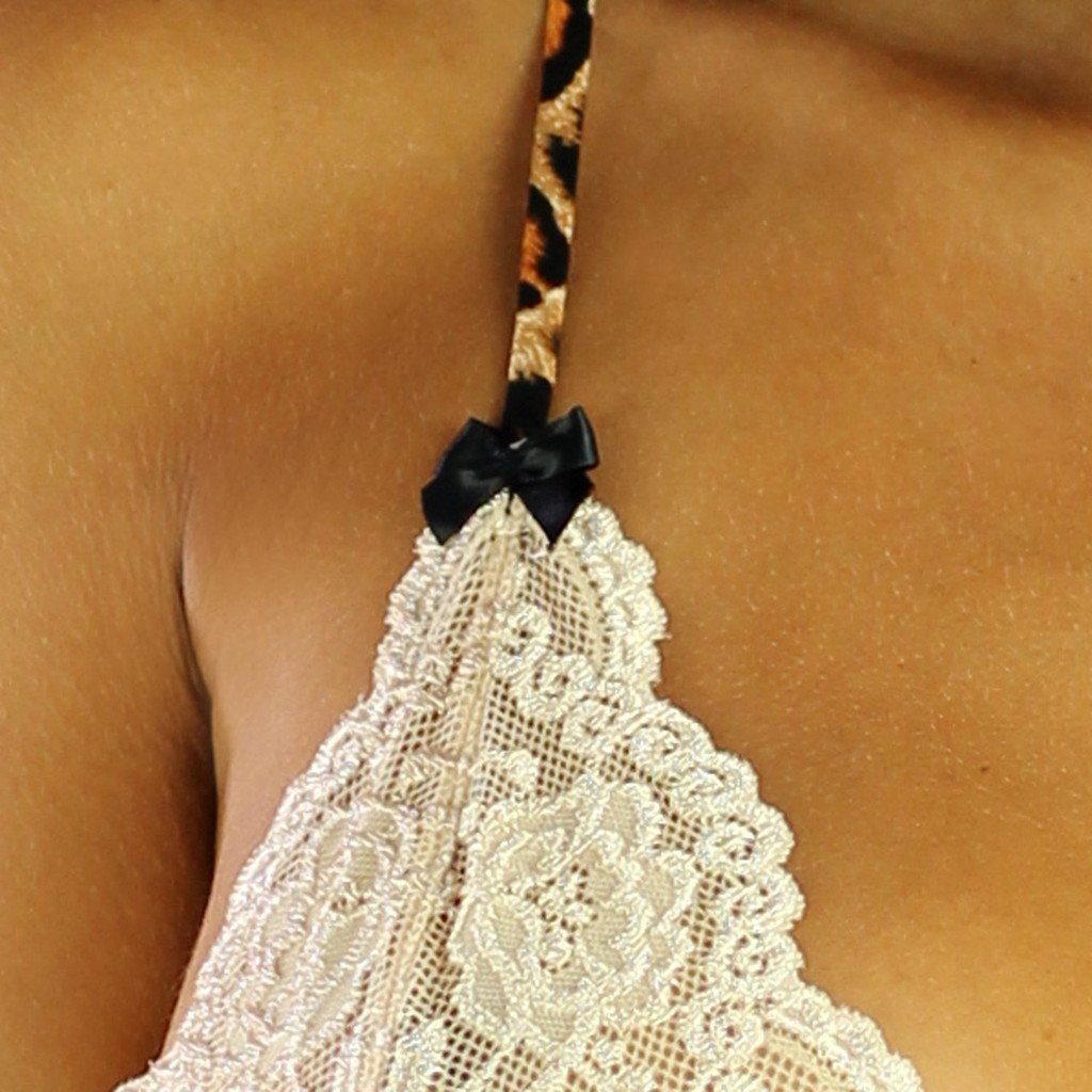 Nude Sahara sand lace is detailed beautifully by the leopard print strap, and black satin bows.