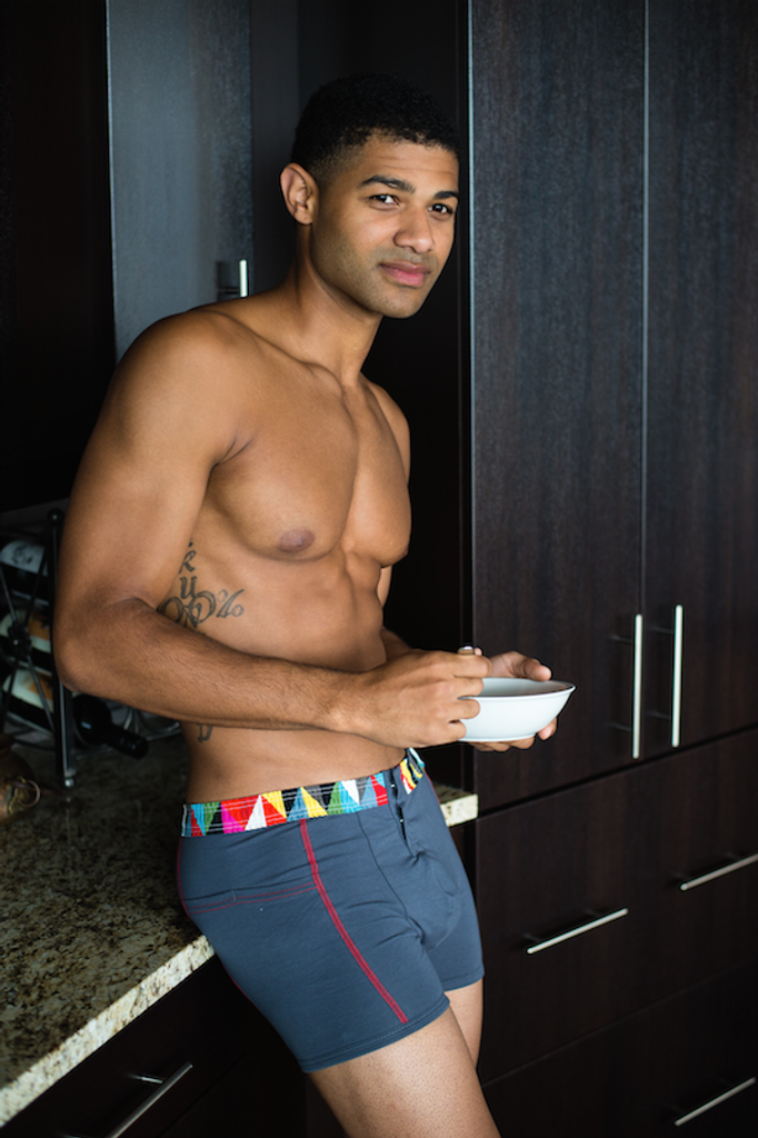 Brandon eating cereal in Charcoal Gray FOXERS Boxer Briefs.