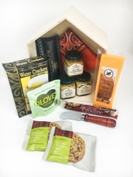 Wooden shadowbox in the shape of a house is filled with tasty treats for the new homeowner!
