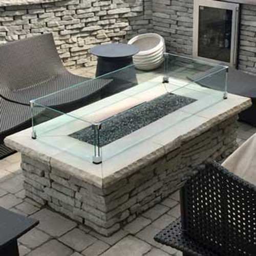 Custom rectangle glass wind guard around a long rectangle fire pit