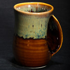 Handwarmer Mug in Mocha. Available with right-handed or left-handed handles. Please call (970) 586-2151 to purchase.