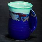 Handwarmer Mug in Mystic Water. Available with right-handed or left-handed handles. Please call (970) 586-2151 to purchase.