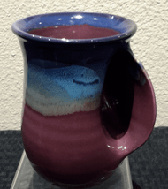 Handwarmer Mug in Purple Passion. Available with right-handed or left-handed handles. Please call (970) 586-2151 to purchase.