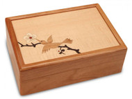 Made from American Cherry wood, this valet box has a beautiful marquetry inlay of a hummingbird. Other woods used include Tiger Maple, Wenge, Aspen, and Bloodwood. Inside features ring inserts and dividers to store all kinds of rings, bracelets and more. This box measures 9 inches x 6 inches x 2 3/4 inches.