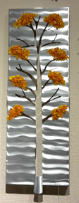 """Four Seasons - Fall, 10""""x27"""" by Sondra Gerber Hand brush aluminum and fused glass wall sculpture.  The use of positive and negative shapes within the intricate cut of the designs cast alluring shadows that interact with the piece itself."""