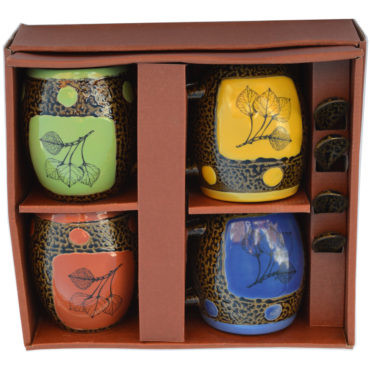 This box set holds four ash glazed mugs each with their own spoon by Always Azul Pottery. Each mug holds 14 oz.  Box Set Colors includes: Avocado Green, Blue, Coral, Yellow Always Azul mugs are available in several decal options. Please call to check availability of current designer decals for Box Sets.