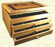 3 Drawer Jewelry Box by Randy West These boxes have a fllp top plus three drawers lined with black velvet and removable wood dividers. Due to the nature of the wood types used, their individual striations, the flow of grains, and the natural tonal variations in wood color, no two designs are exactly alike.   Call a sales associate to get a current photo of pieces on hand. Earthwood Artisans, 970.586.2151