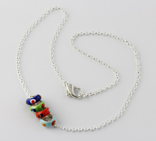 """""""Necklace with Colored Rondells"""" by Ann Carol Jewelry based in Boundbrook, NJ. Each piece is made with sterling silver and accented with hand painted enamel designs & 16 Inch Chain."""