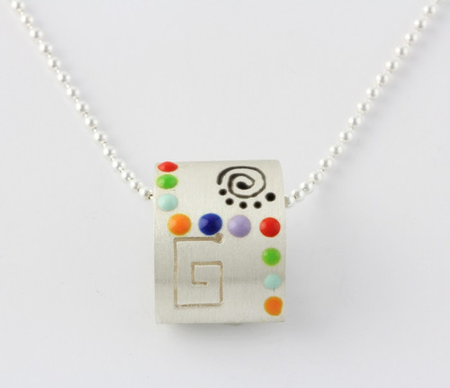 """""""3-D Rectangle Miro Pendant with Colorful Geometric Designs"""" by Ann Carol Jewelry based in Boundbrook, NJ. Each piece is made with sterling silver and accented with hand painted enamel designs on a 16 Inch Bead Chain."""