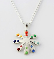 """Tiny Flower Pendant with Primary and Jewel Dots"" by Ann Carol Jewelry based in Boundbrook, NJ. Each piece is made with sterling silver and accented with hand painted enamel designs on a 16 Inch Bead Chain."