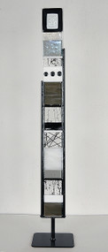 """Small Standing Totem in Black and White by Hands On Art Glass. 3""""x27"""", fused glass in a black metal stand. Please call our galleries to see which pieces are currently on hand."""