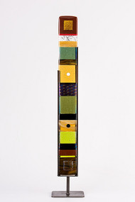 """Small Standing Totem in Earth by Hands On Art Glass. 3""""x27"""", fused glass in a grey metal stand. Please call our galleries to see which pieces are currently on hand."""