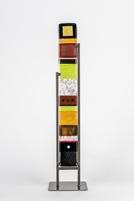 """Medium Standing Totem in Earth by Hands On Art Glass. 4""""x30"""", fused glass in a grey metal stand. Please call our galleries to see which pieces are currently on hand."""